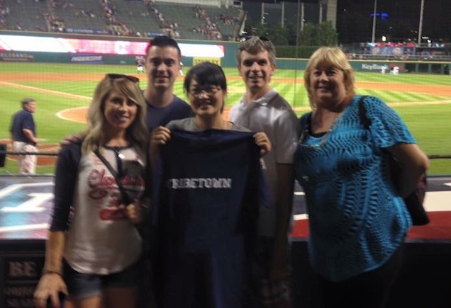Lily (center) is pictured with Nick Scolaro (2nd from Left), during her visit to the USA in 2015, she was able to enjoy a Cleveland Indians game.